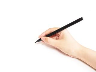 ペンで書きはじめる女性の手