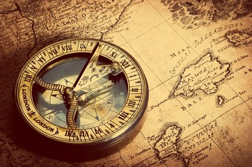 Fototapete - Old compass on vintage map. Retro stale.