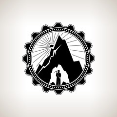 Miner in the Helmet  is Holding Pickaxe in the Bowels of the Mountain  on a Background of the Sunburst, Label or Badge Mine Shaft, Mining, Vintage Emblem of the Mining Industry