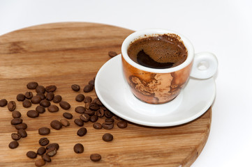 Cup of coffee on the wooden board