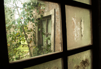View on poor housing through a dirty window