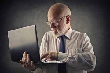 Businessman using his laptop