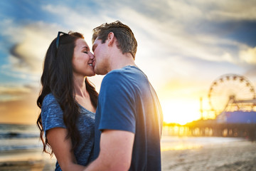 romantic couple kissing at santa monica