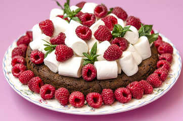 Oatmeal cake with marshmallow and raspberry