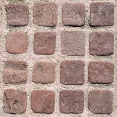 Small brown paves with pink joints