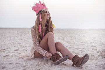Beautiful young stylish women with dreadlocks and feather hat