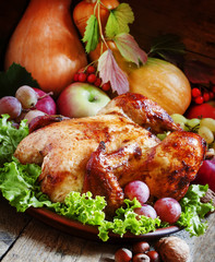 Festive baked chicken with autumn berries, fruits, nuts and vege