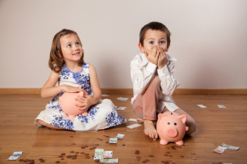 Funny children collecting money in the piggy bank