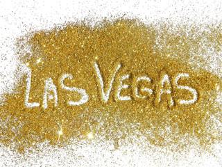 Inscription Las Vegas on golden glitter sparkle on white background