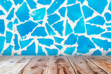 blue glass mosaic wall and brown wooden floor