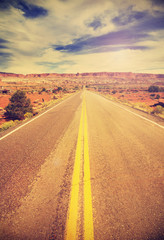 Retro vintage filtered picture of a country highway, USA.