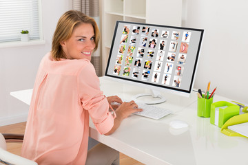 Female Editor Working With Photos On Computer