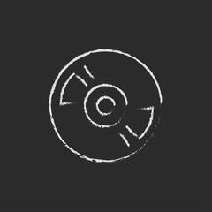 Disc icon drawn in chalk.