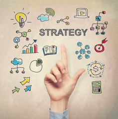 Hand pointing to Strategy concept