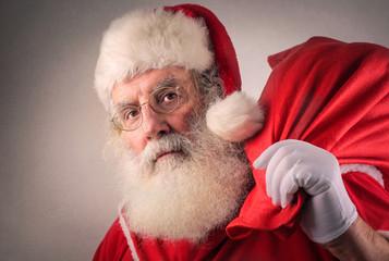Serious Santa Claus holding a bag