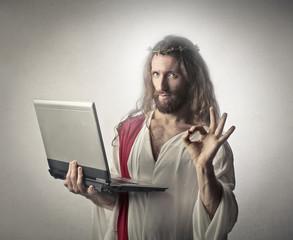 Jesus holding a pc