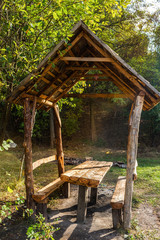 Wooden gazebo in park, early fall. Vertical image