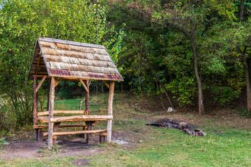 Wooden gazebo in park, early fall.
