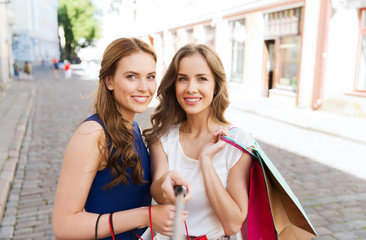 women shopping and taking selfie by smartphone