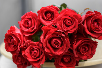 bouquet of red roses lying on a plate