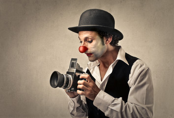 Clown taking a picture