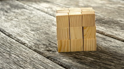 Cube assembled from 27 smaller wooden cubes