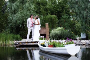 Newlyweds near a pond / Молодожёны возле пруда