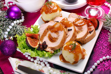 christmas dinner with loin of pork stuffed with figs and potato