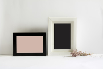 empty picture frames, decorated with pink flowers