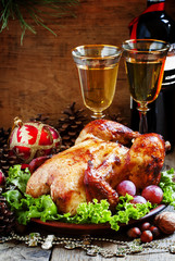 Christmas roast turkey or chicken decorated with nuts, fir cones