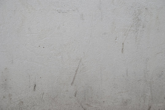 Scuffed concrete wall with grunge marks