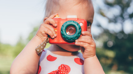 Adorable Little Girl Takes Pictures with Children's Camera