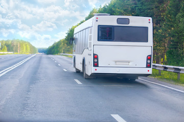 bus goes on  country highway