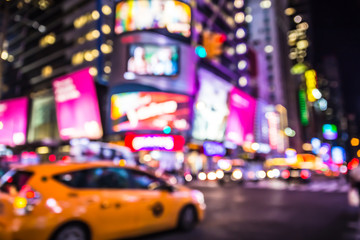 Foto auf Leinwand New York TAXI Defocused blur of Times Square in New York City with lights at night and taxi cab