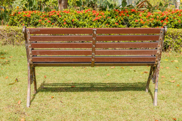 Wooden Park Bench with sunlight,Bench Chair In the garden on bac