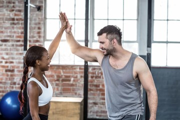 Fit couple doing a high five