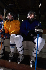 ice hockey players on bench