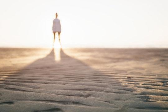 defocused photo of girl standing on beach