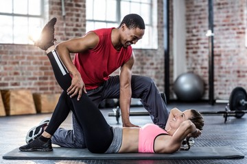 Fit couple doing a leg stretching
