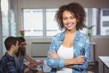 Portrait of happy creative businesswoman