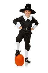 Thanksgiving: Pilgrim With Foot On Pumpkin