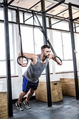 Fit man using gymnastics rings