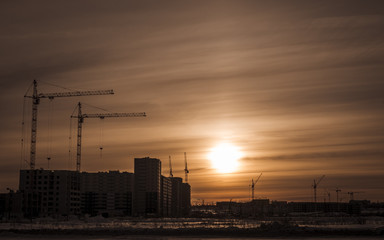 Building of new houses and hoisting tower cranes