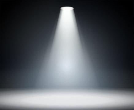 Dark background with spotlight.