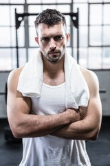 Fit man with towel on shoulders