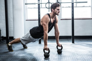 Fit man working out with kettlebells
