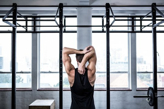 Fit man stretching his arms