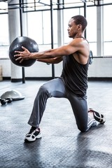 Fit man working out with ball