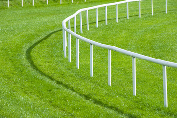 close up railing bend of a horse race track