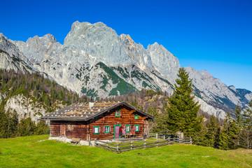 Deurstickers Landschappen Traditional mountain chalet in the Alps in autumn